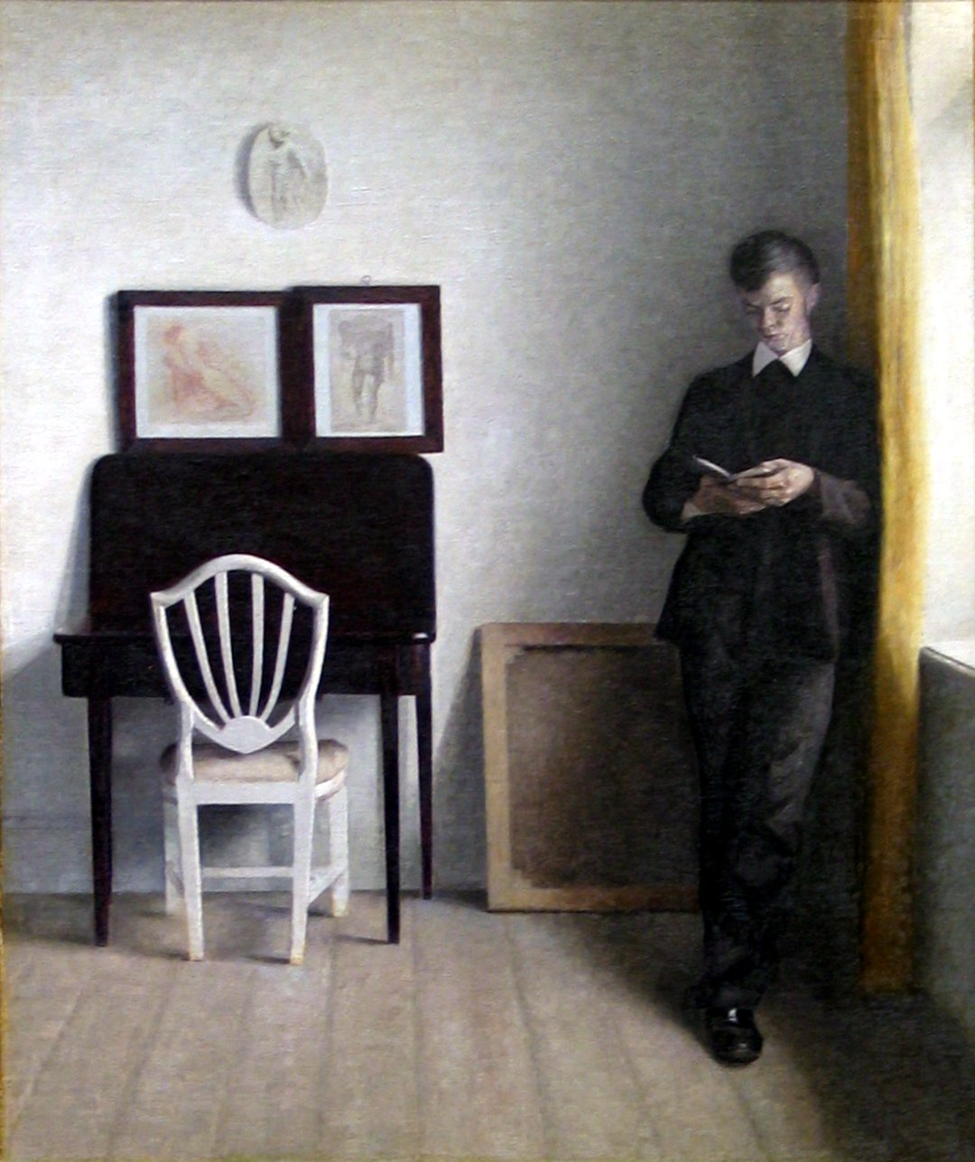Vilhelm_Hammershøi_1898_-_Interiør_med_læsende_ung_mand[1].jpg